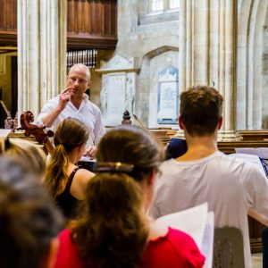 Jonathan Williams conducting the musicians of St Hilda's College, Oxford